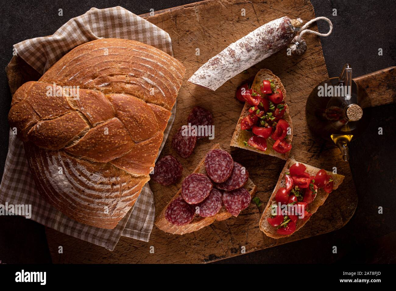 Fresh Homemade Bread With Salami And Bruschetta With Tomato Basil