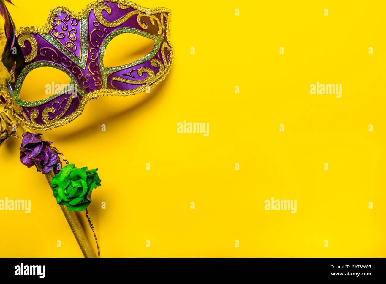 Mardi Gras mask on a bright yellow background Stock Photo