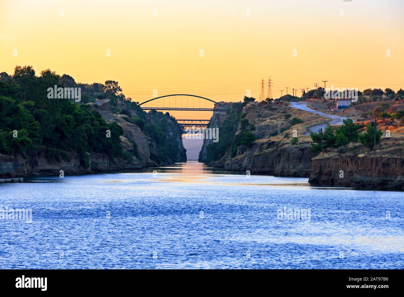 View of the transport bridges over the Corinth Canal in Greece against the morning light of the beginning day. Stock Photo