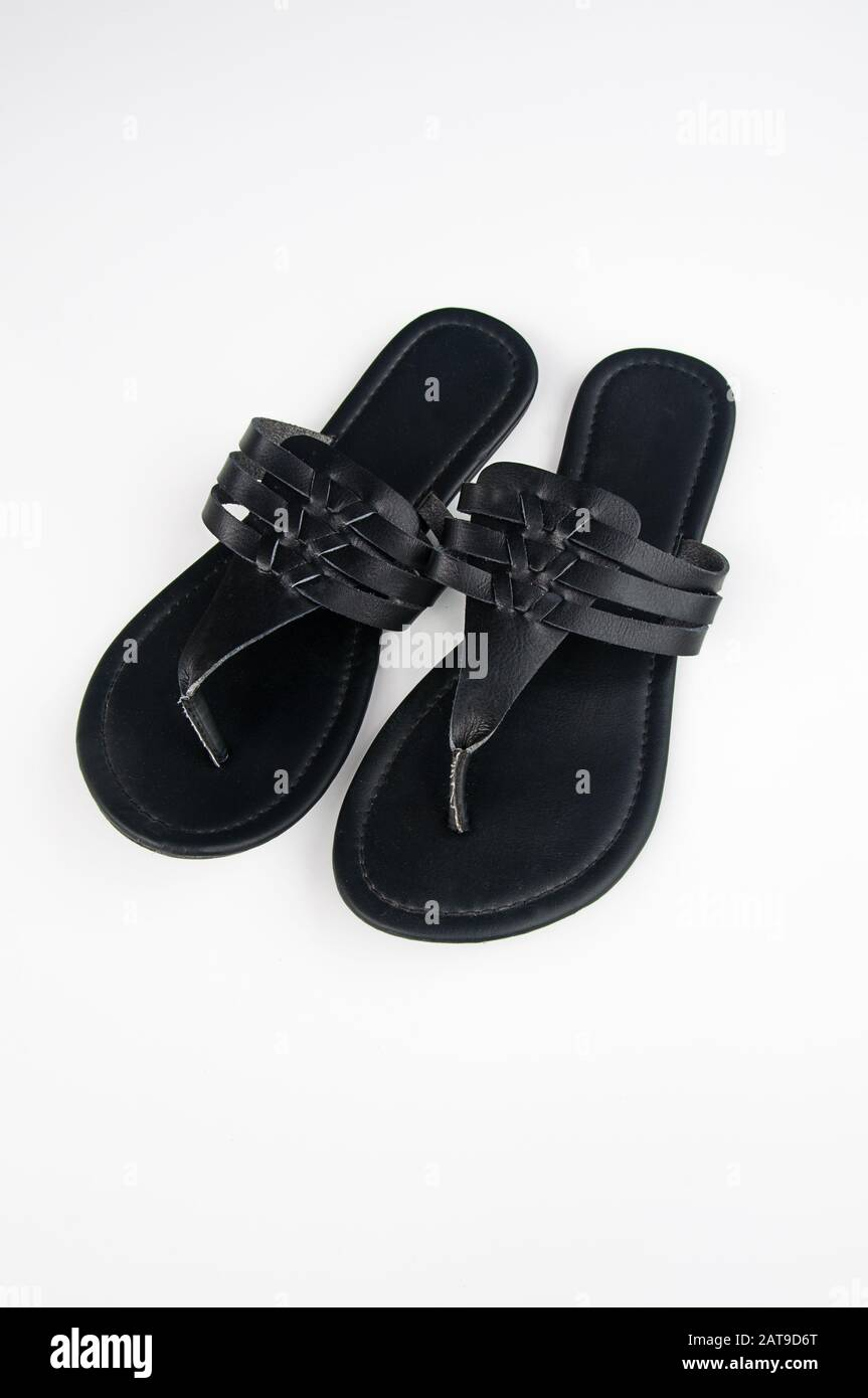 Black flat sandal shoes isolated on a