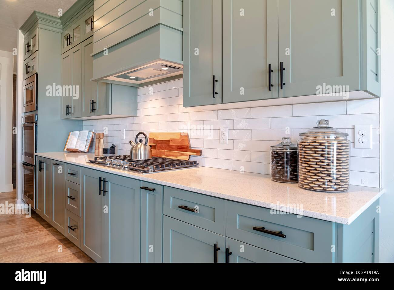 - Kitchen Interior With Cooktop On White Counter Top Under Hanging