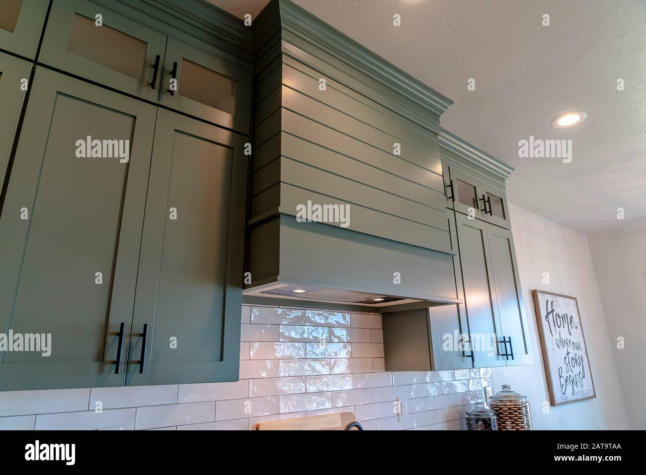 Kitchen Interior With Hanging Cabinets Against Tile Backsplash And Ceiling Stock Photo Alamy