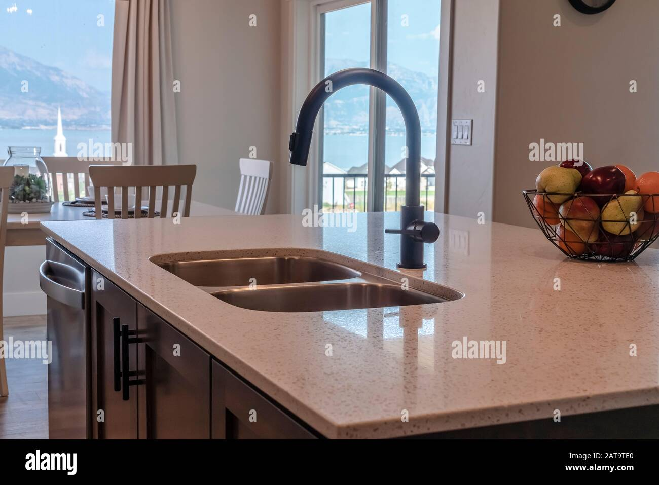 Kitchen Island With Double Basin Undermount Sink Black Faucet And Dishwasher Stock Photo Alamy