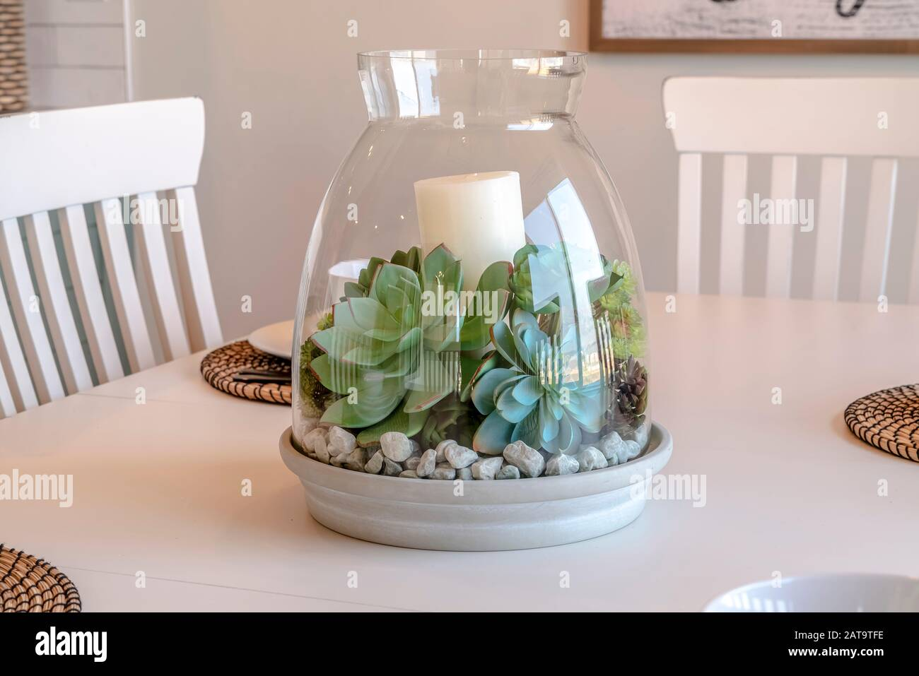 Ornamental Glass Jar With Plants And Candle On The Dining Table Of Home Stock Photo Alamy