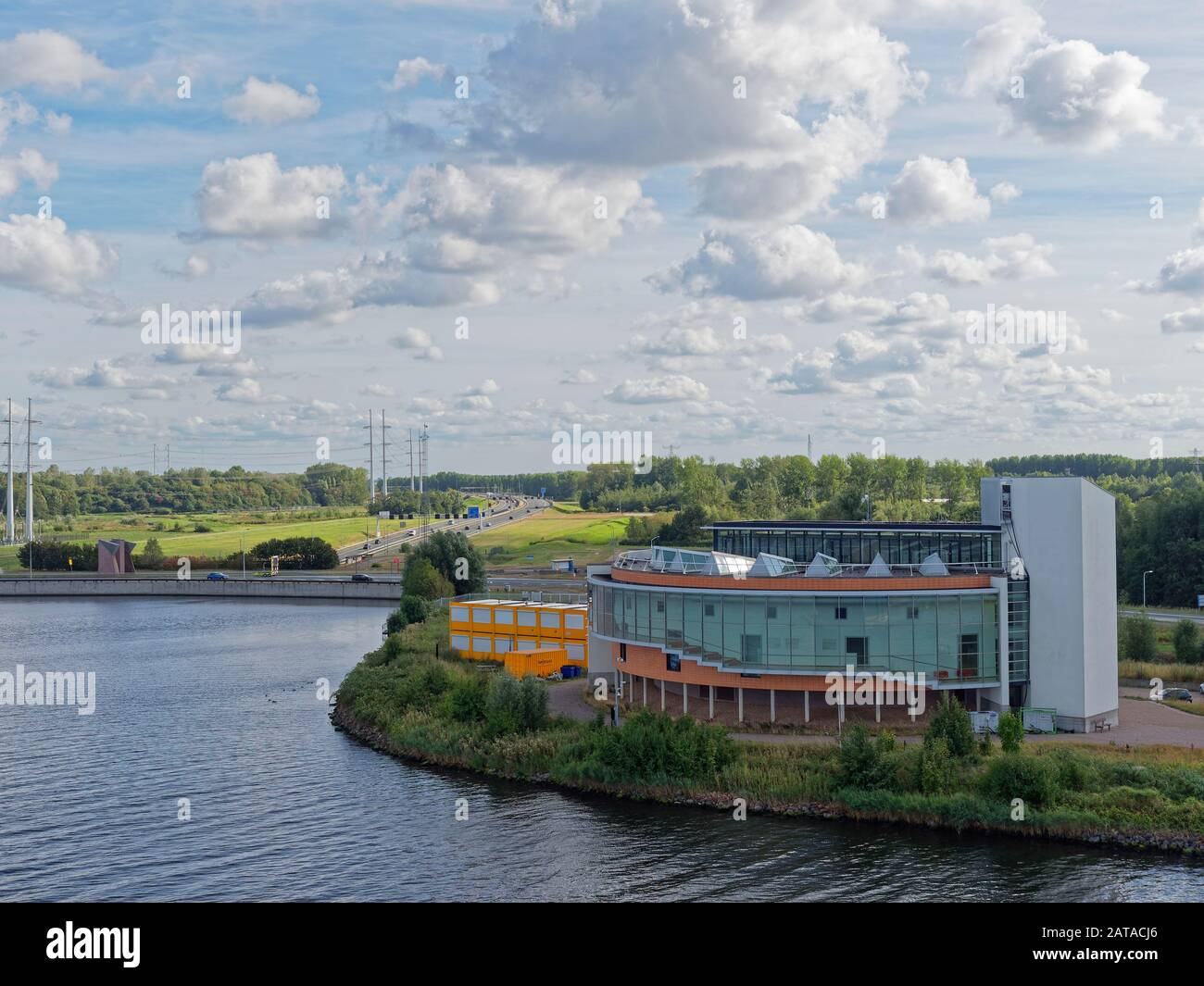 A modern Commercial building on the banks of the North Sea Canal, close to the A9 motorway which passes under the canal at the Velser tunnel. Stock Photo