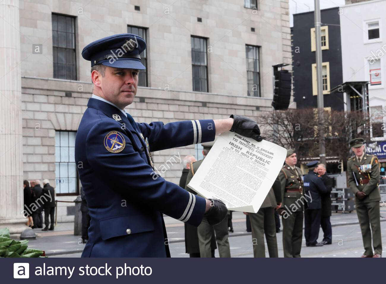 A captain in the Irish army displays a copy of the Proclamation of the Irish Republic which he had just read at Easter 1916 ceremonies in Dublin Stock Photo