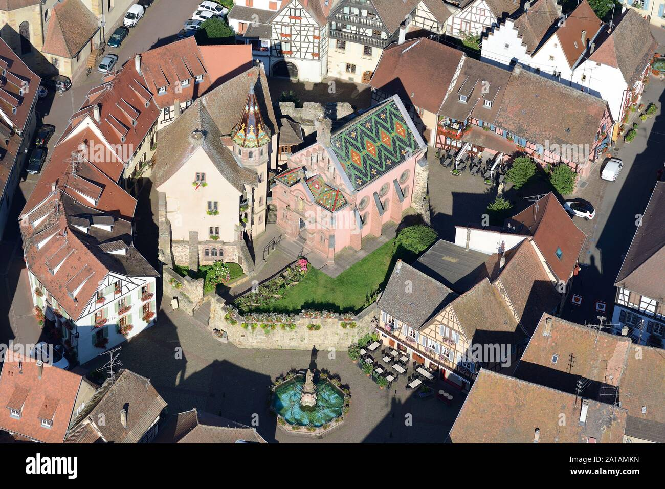 AERIAL VIEW - Castle of Saint-Léon-Pfalz and traditional half-timbered homes. Eguisheim, Haut-Rhin, Alsace, Grand Est, France. Stock Photo