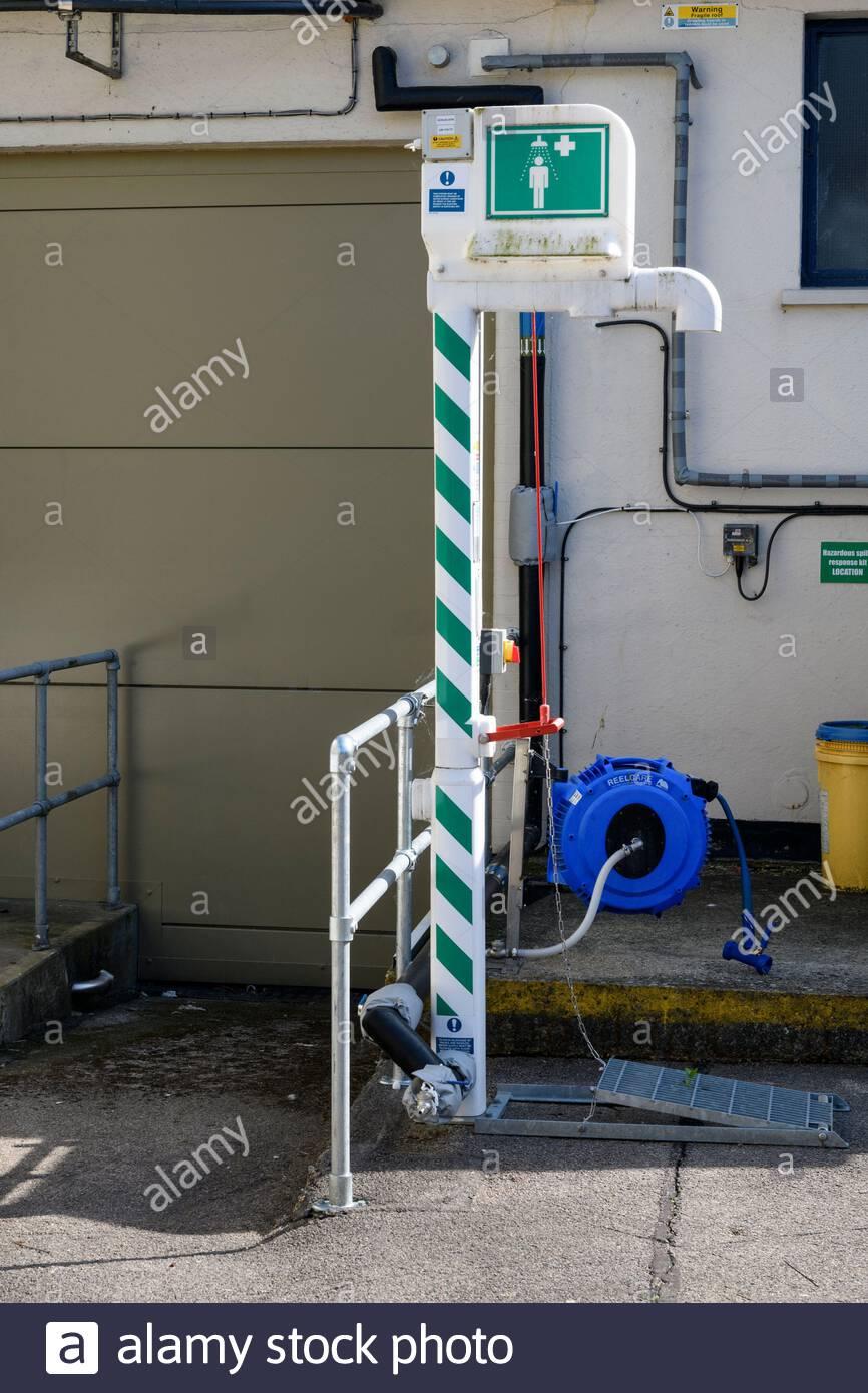 Emergency Shower outside business unit, Beaminster, Dorset, England, UK Stock Photo