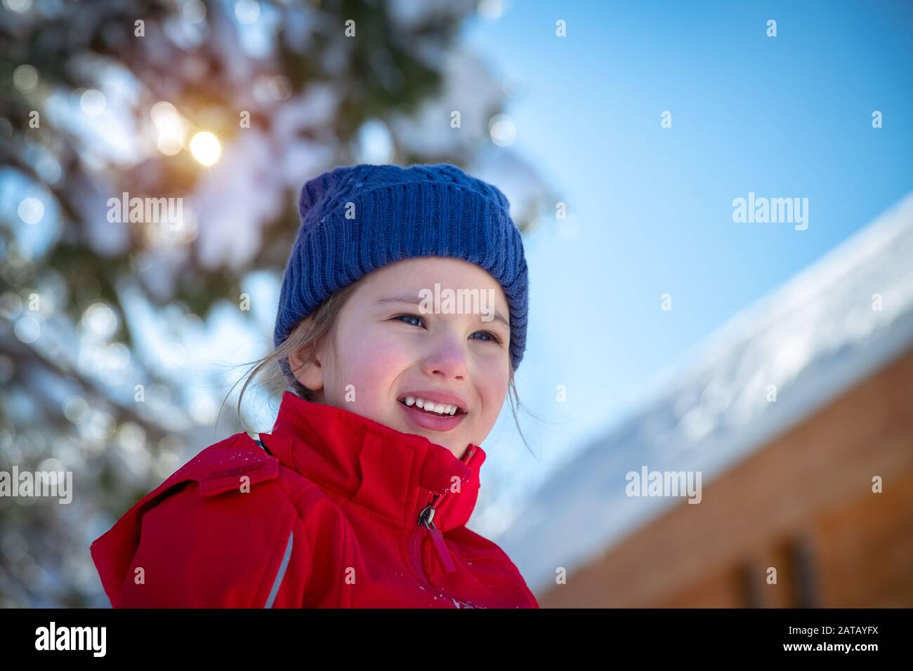 Portrait of a cute little girl having fun outdoors, cheerful child enjoying sunny winter day, happy winter holidays Stock Photo
