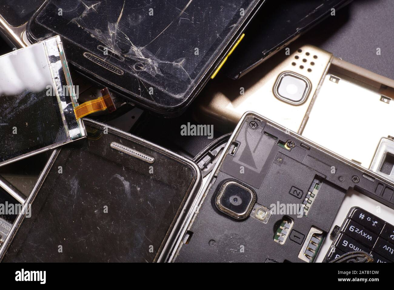 Electronic scrap. Different phones and smartphones not suitable for repair. Stock Photo