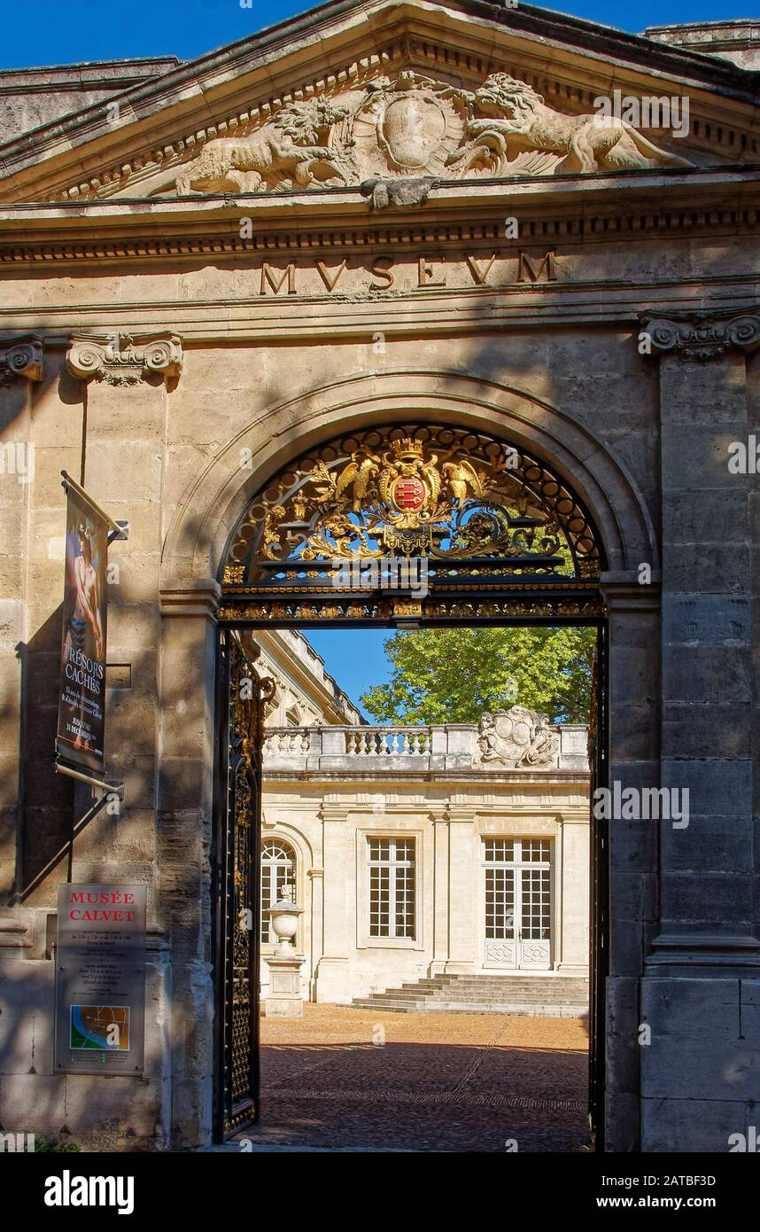 ornate entrance, Calvet Museum, arch, courtyard, 18 century mansion, old stone building, sun, shade, Provence, Avignon, France, summer, vertical Stock Photo