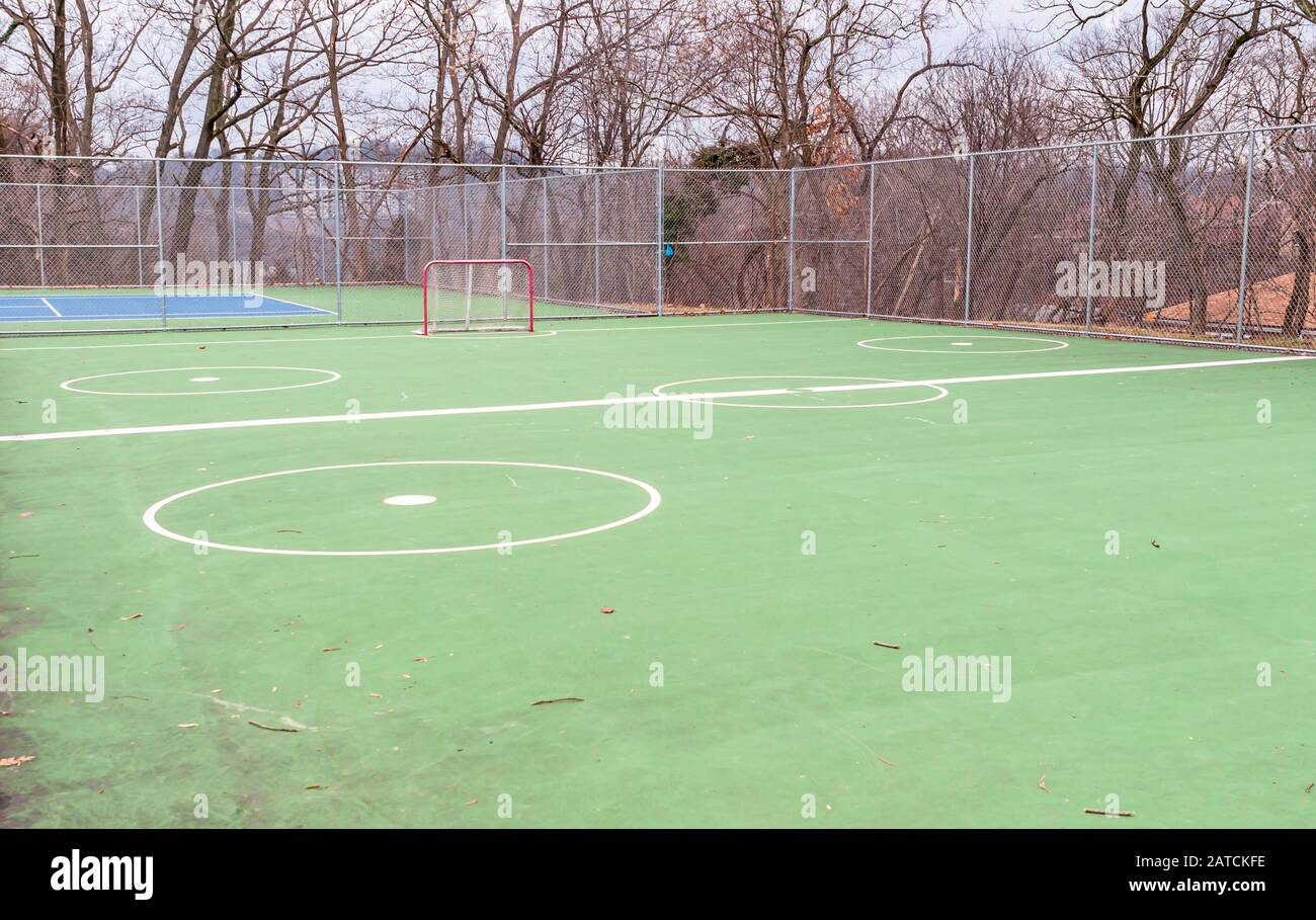 The outdoor hockey deck at the Swisshelm Park playground in Pittsburgh, Pennsylvania, USA on a winter day Stock Photo