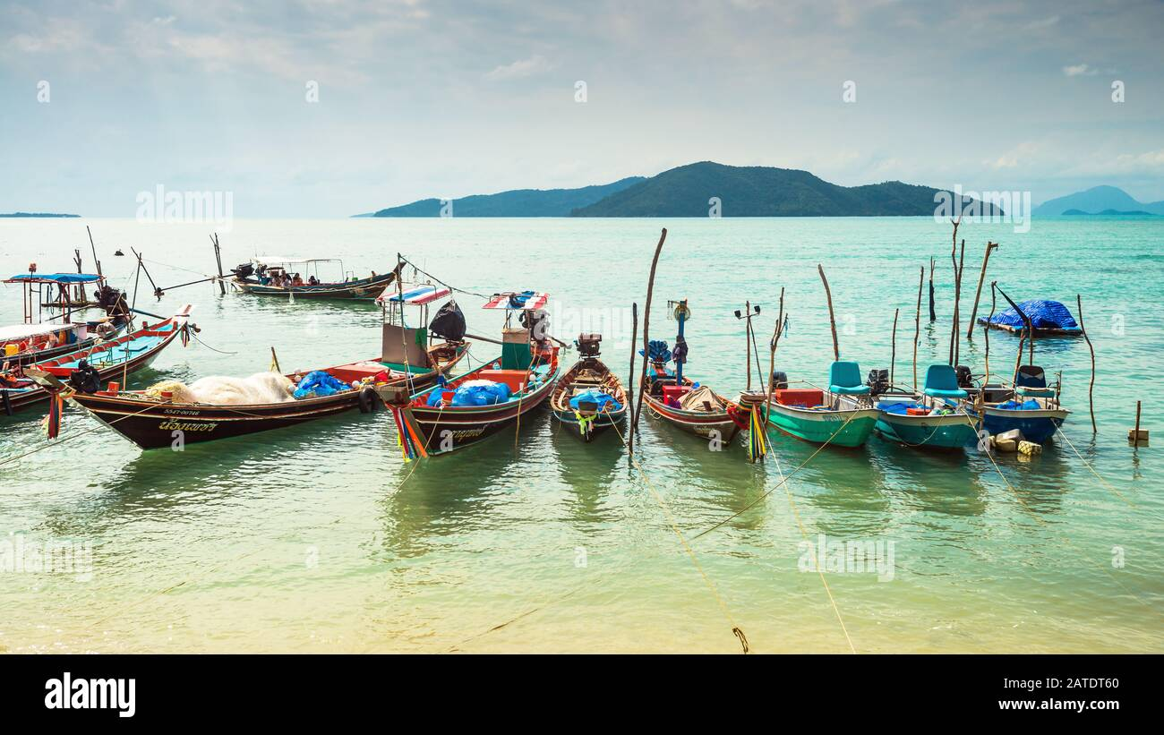 Koh Samui, Thailand - January 2, 2020: Authentic Thai fishing boats docked at Thong Krut beach in Taling Ngam on a day Stock Photo