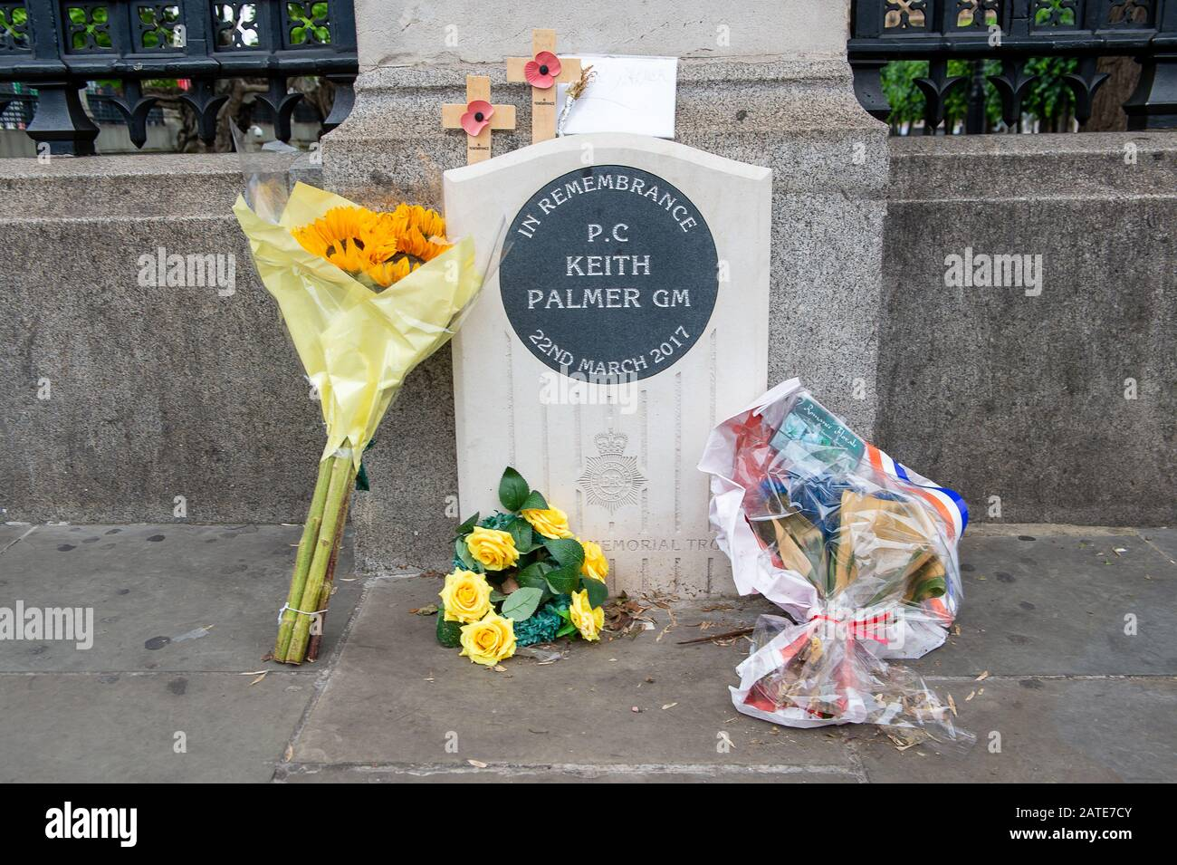 "Westminster, London, UK. 26th June, 2019. Flowers are left in memory of PC Keith Palmer GM who was stabbed and died from his injuries during the Westminster Attack on 22nd March 2017 whilst at work at the House of Commons. Following his death he was posthumously awarded the George Medal which is the second highest award for gallantry ""not in the face of the enemy"". Credit: Maureen McLean/Alamy Stock Photo"
