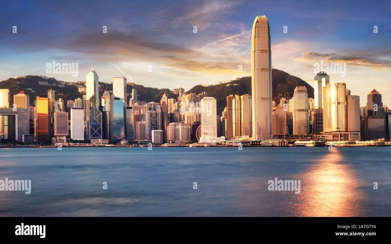 Hong Kong skyline from kowloon, panorama at sunrise, China - Asia Stock Photo