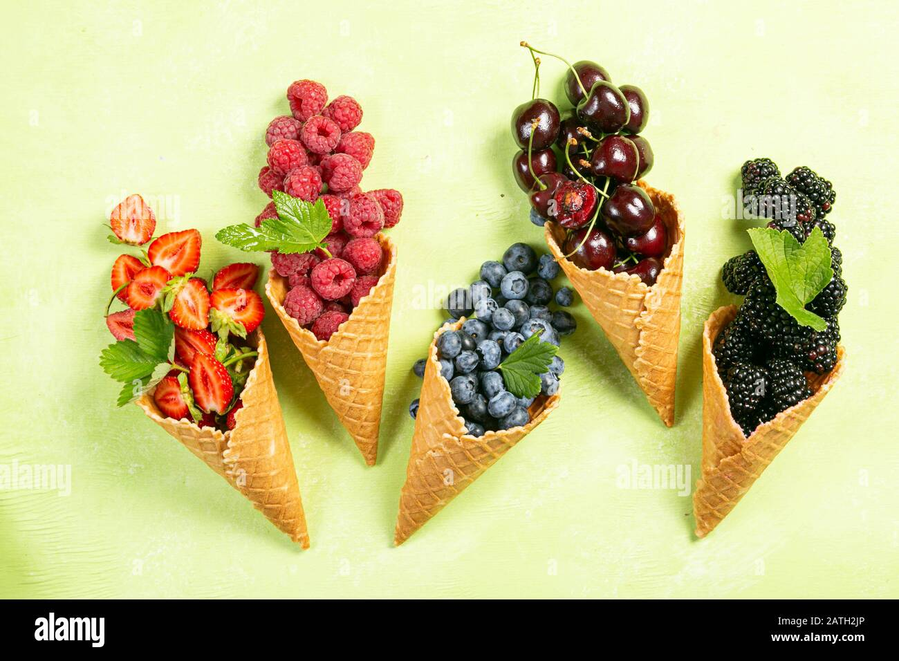 Selection of berries in ice cream cones Stock Photo