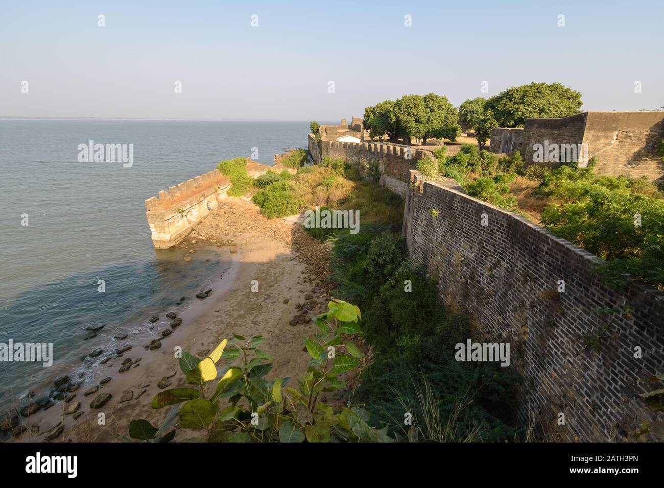 The exterior ramparts and facade of the colonial architecture of the Portuguese era fort in Diu Island. Stock Photo