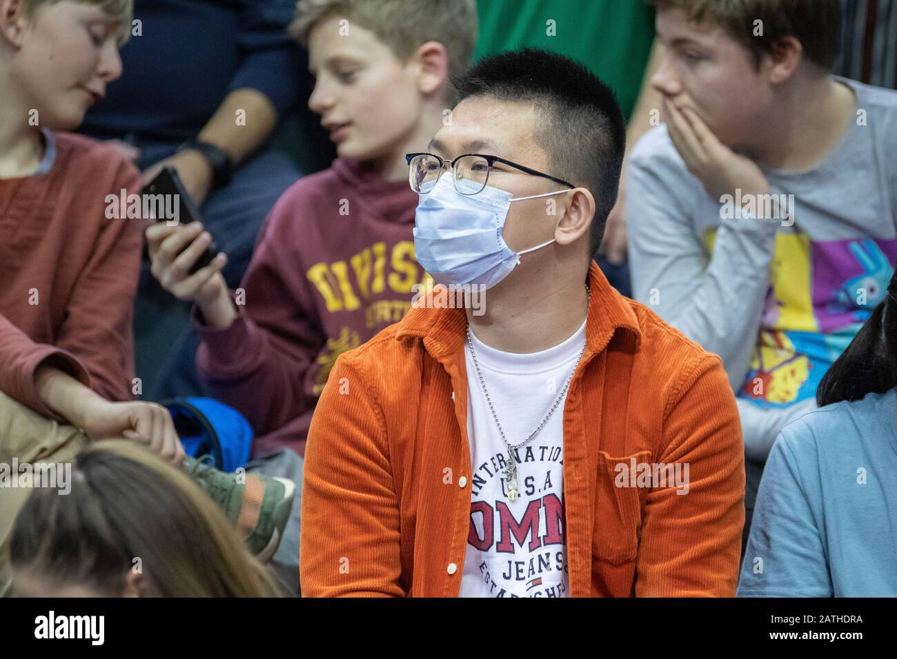 Viewers protects theirselves with a mouthguard for fear of the coronavirus Stock Photo