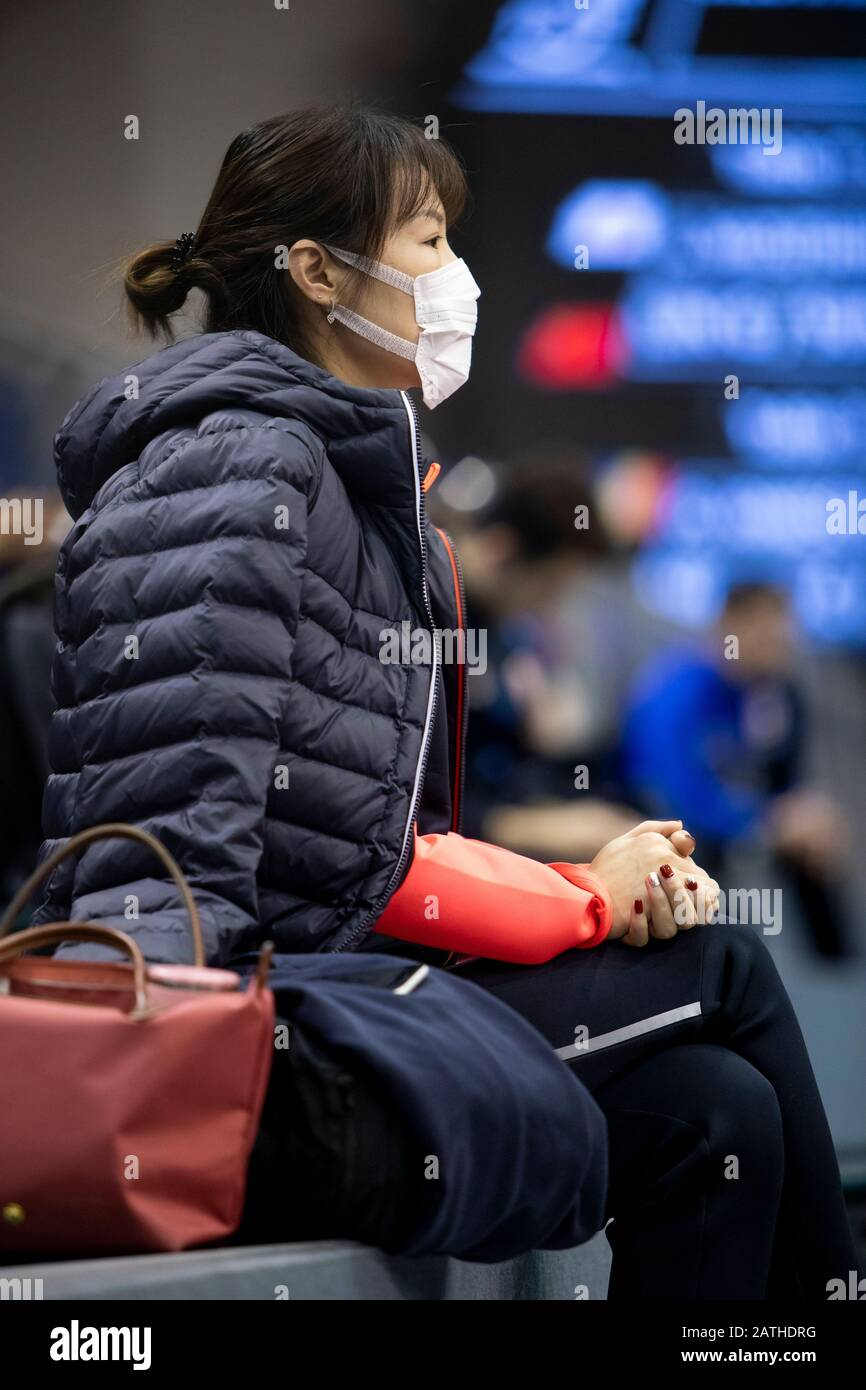 Athlete protects herself with a mouthguard for fear of the coronavirus Stock Photo