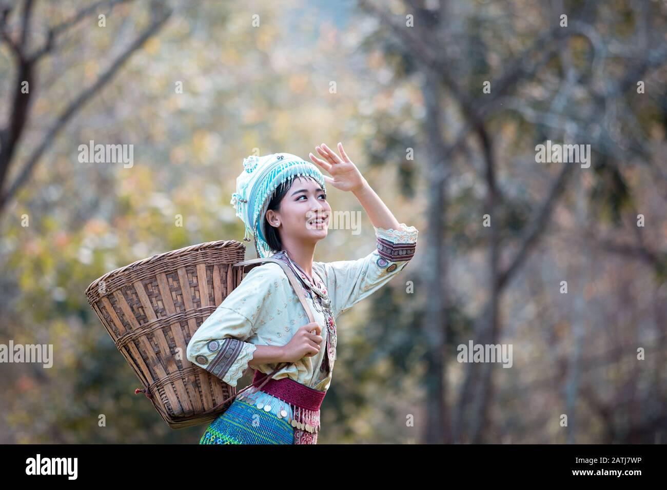 Young woman wearing Hmong traditional dress and enjoying the coffee garden at Doi Pui Chiang Mai Thailand. Stock Photo