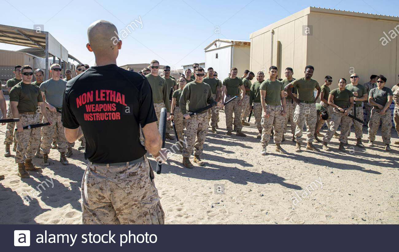 U.S. Marines assigned to Special Purpose Marine Air-Ground Task Force – Crisis Response - Central Command (SPMAGTF-CR-CC) 19.2, receive a safety brief before participating in an oleoresin capsicum spray course during a non-lethal weapons training exercise, in Kuwait, Jan. 27, 2020. The SPMAGTF-CR-CC is a multiple force provider designed to employ ground, logistics and air capabilities throughout the Central Command area of responsibility.  Where: Kuwait When: 27 Jan 2020 Credit: U.S. Marine Corps/Cover Images  **Editorial use only** Stock Photo