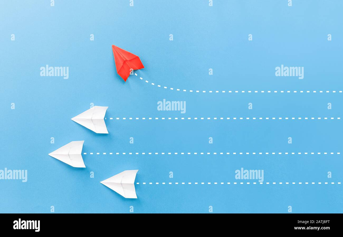 New ideas creativity and different innovative solution. Business concept. A group of paper airplanes, one plane is flying in the other direction, diff Stock Photo