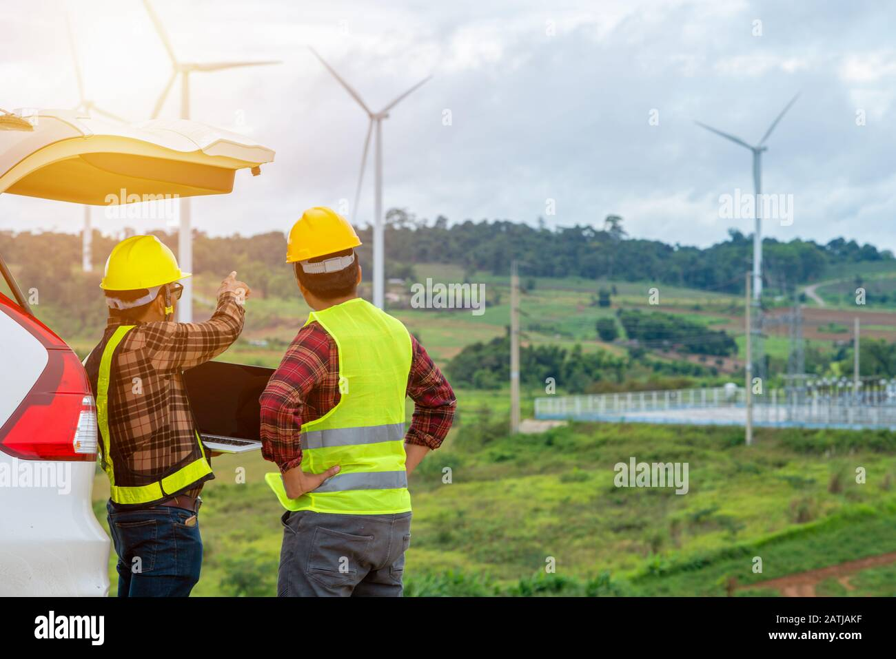 Two Engineering checking the wind turbine production energy electric Stock Photo