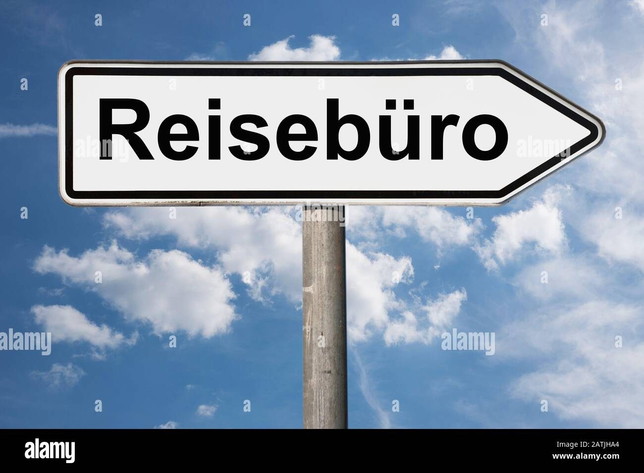 Detail photo of a signpost with the inscription Reisebüro (Travel agency) Stock Photo