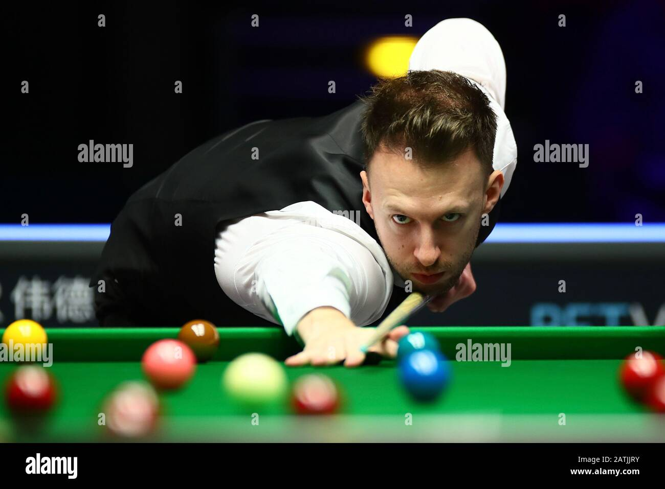 Judd Trump of England plays a shot to Neil Robertson of Australia ...