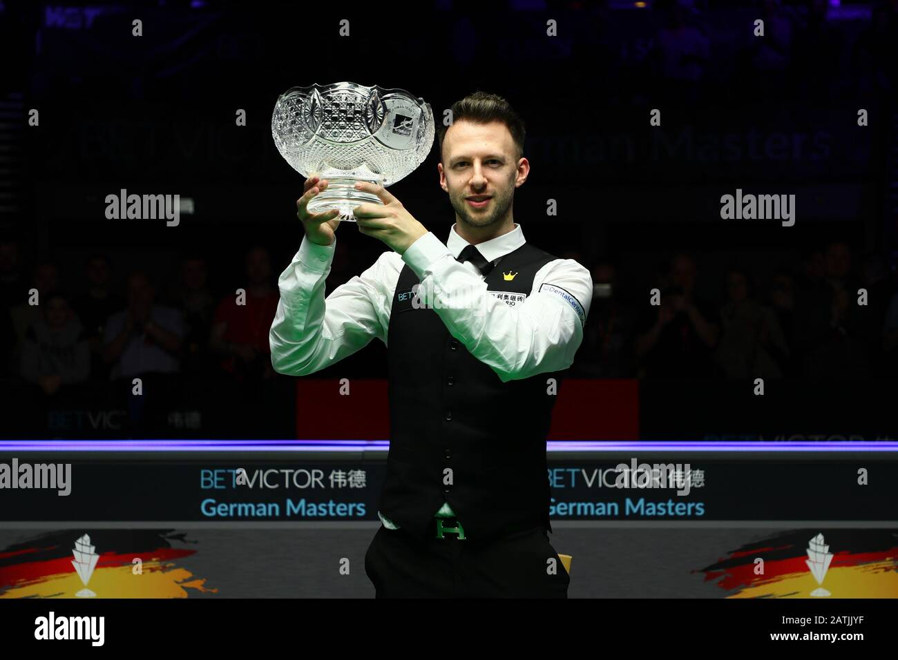 Judd Trump of England holds the trophy after defeating Neil ...