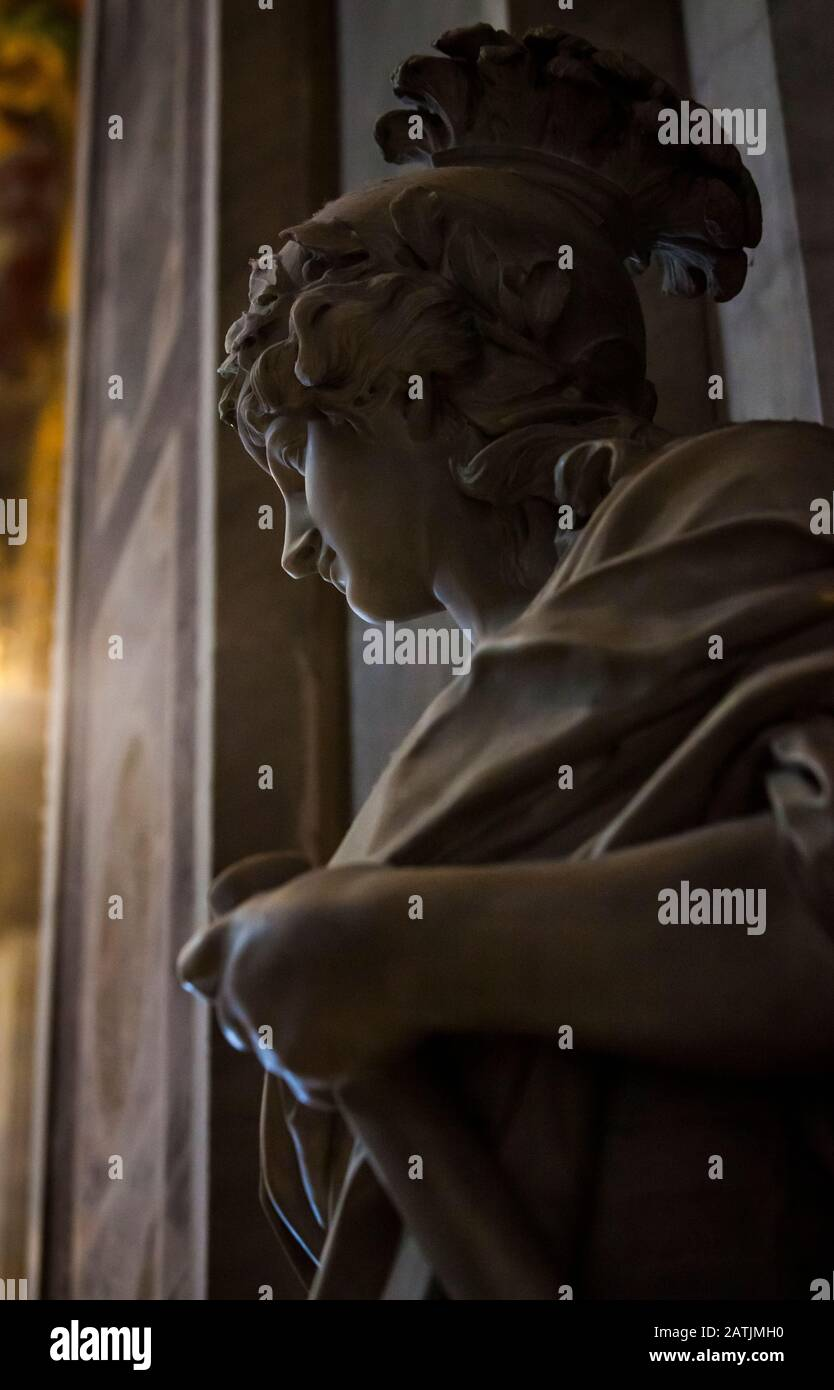A detail of a statue, Leo XI  in St. Peters Basilica, Vatican City, Rome, Italy.  This is the allegorie, Fortitude next to the Stock Photo