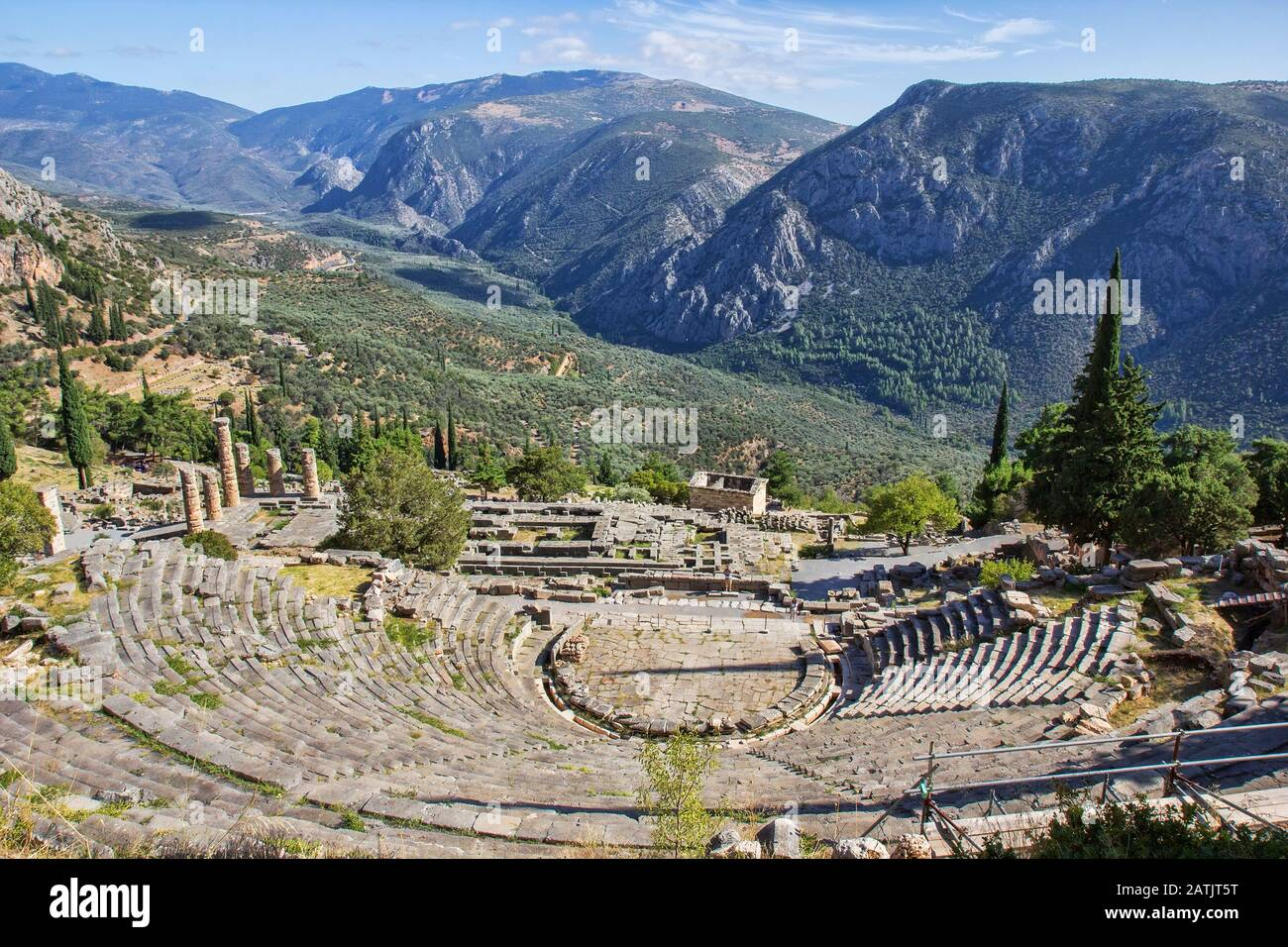 Ruins of the ancient theatre and Temple of Apollo at the archeological site of Delphi, a UNESCO World Heritage Site, a religious sanctuary dedicated t Stock Photo
