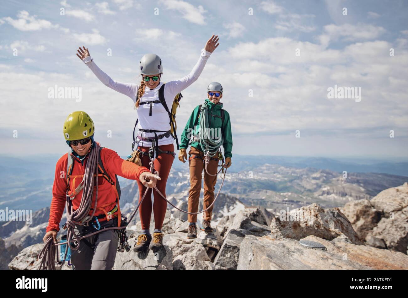 Three rock climbers celebrate reaching summit of Grand Teton, Wyoming Stock Photo