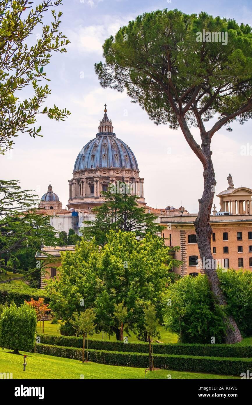 Rome, Vatican City / Italy - 2019/06/15: Panoramic view of St. Peter's Basilica - Basilica di San Pietro in Vaticano - dome by Michelangelo Buonarotti Stock Photo
