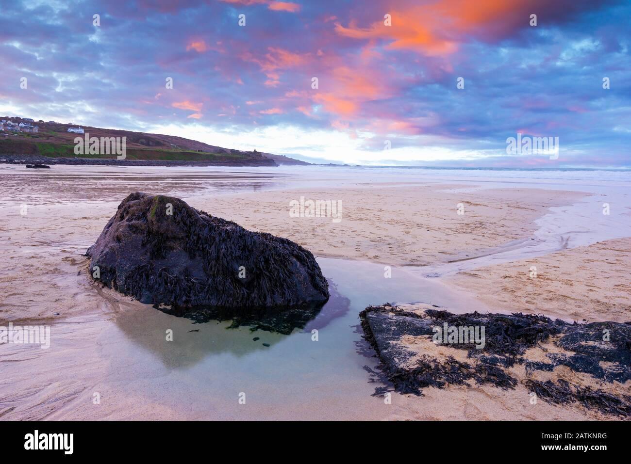 Vibrant sunset on the golden sand at Porthmeor Beach St Ives Cornwall England UK Europe Stock Photo