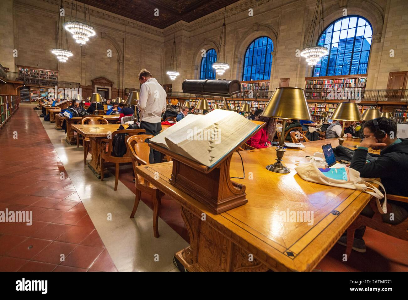 New York City, USA - December 27, 2017: Readers in The New York Public Library est. 1902. Manhattan, NYC. Stock Photo