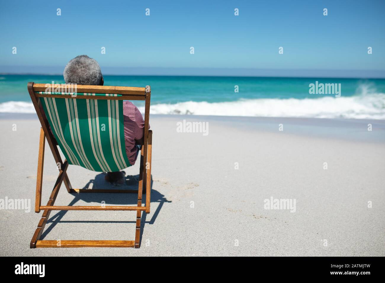 Old man relaxing at the beach Stock Photo