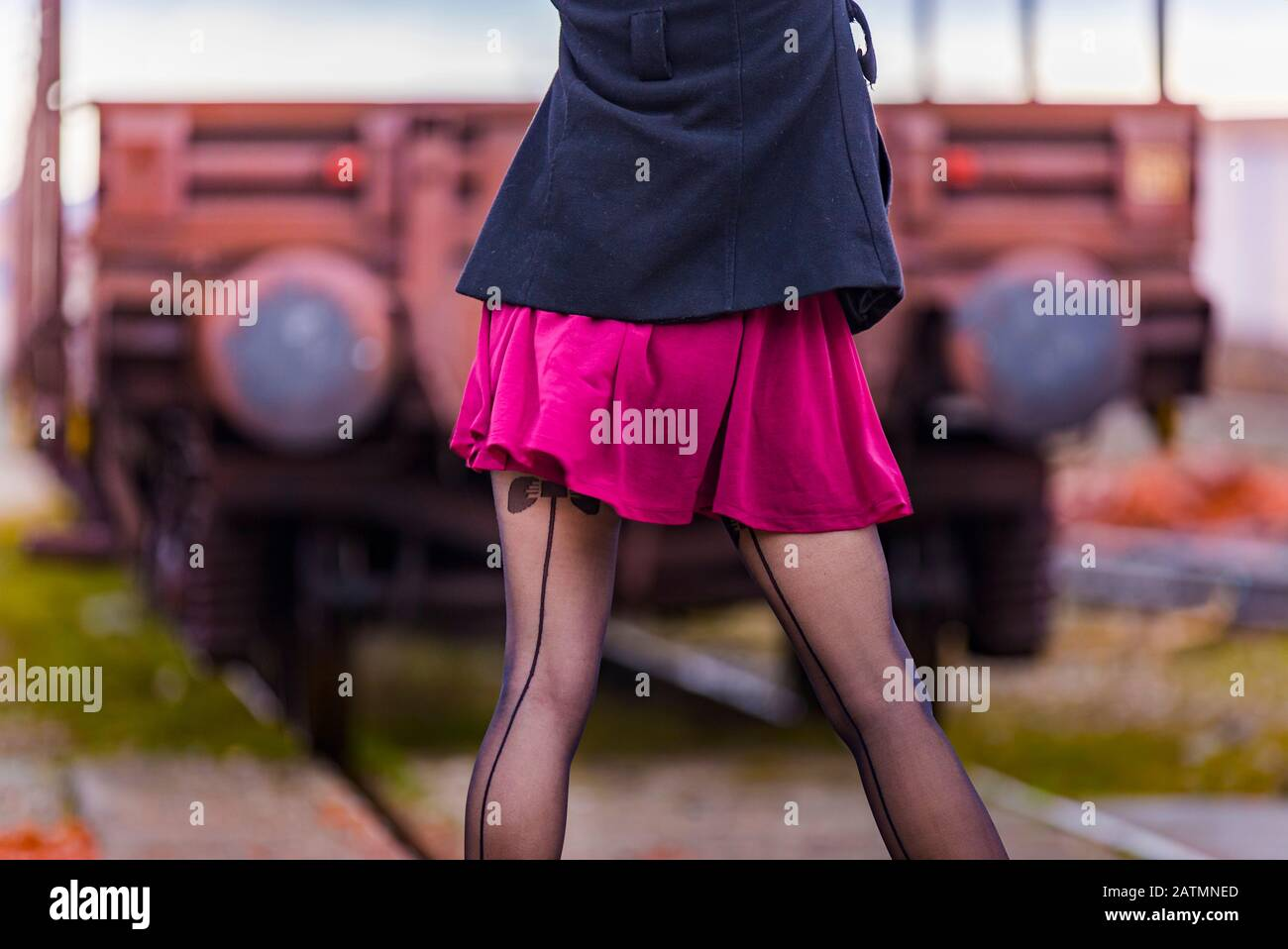 Teen girl twisted seamed stockings view from back rear behind rearview cropped crop Stock Photo