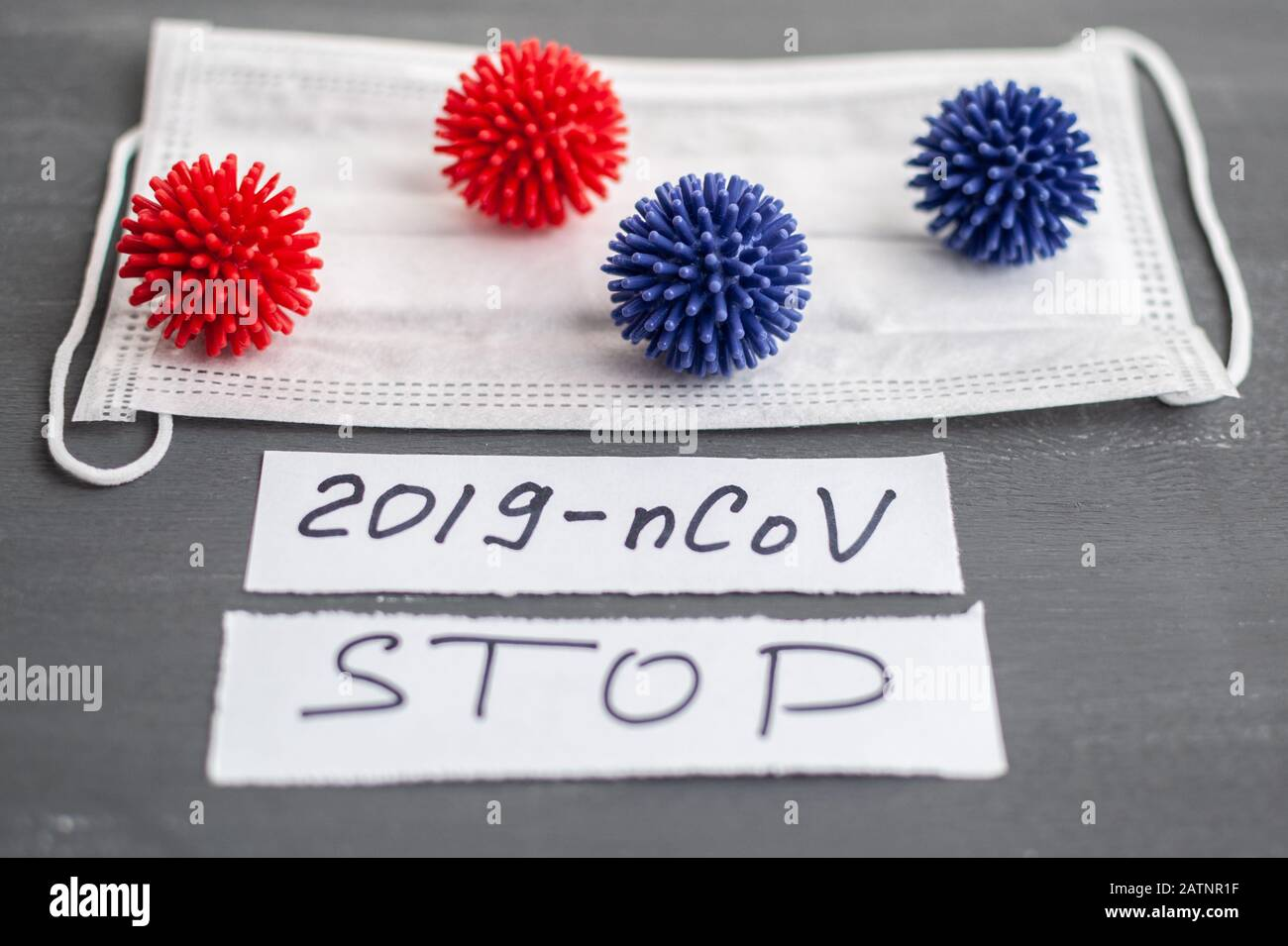 Abstract coronavirus strain model from Wuhan, China. Outbreak Respiratory syndrome and Novel coronavirus 2019-nCoV with free space on grey background. Stock Photo