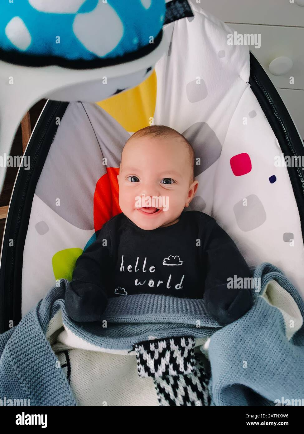 Little Cute Boy Sitting In Baby Rocker And Smiling Modern Toys And Center For Children Stock Photo Alamy
