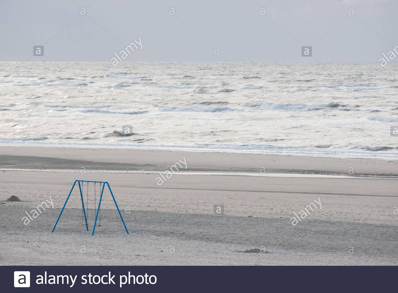 a double seated swing on the beach of langeoog island Stock Photo