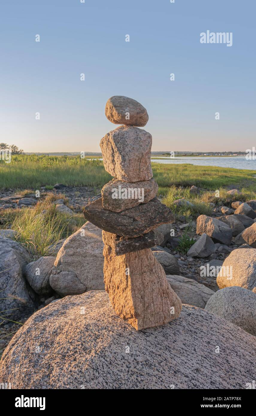 cairn rock formation on ocean point Stock Photo