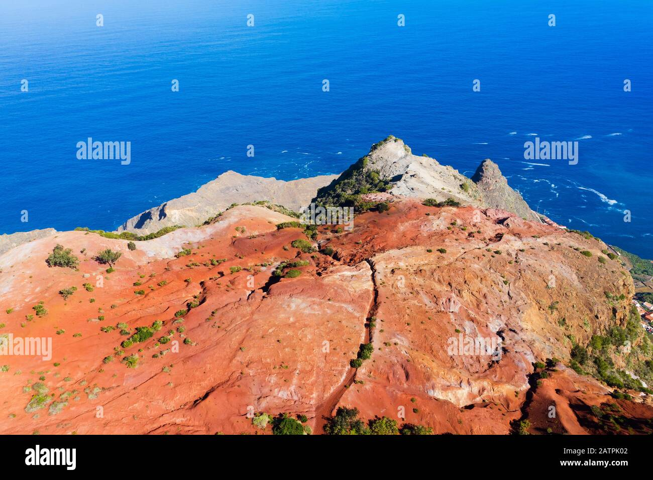 Eroded mountain slope with red earth at the coast, near Agulo, drone recording, La Gomera, Canary Islands, Spain Stock Photo