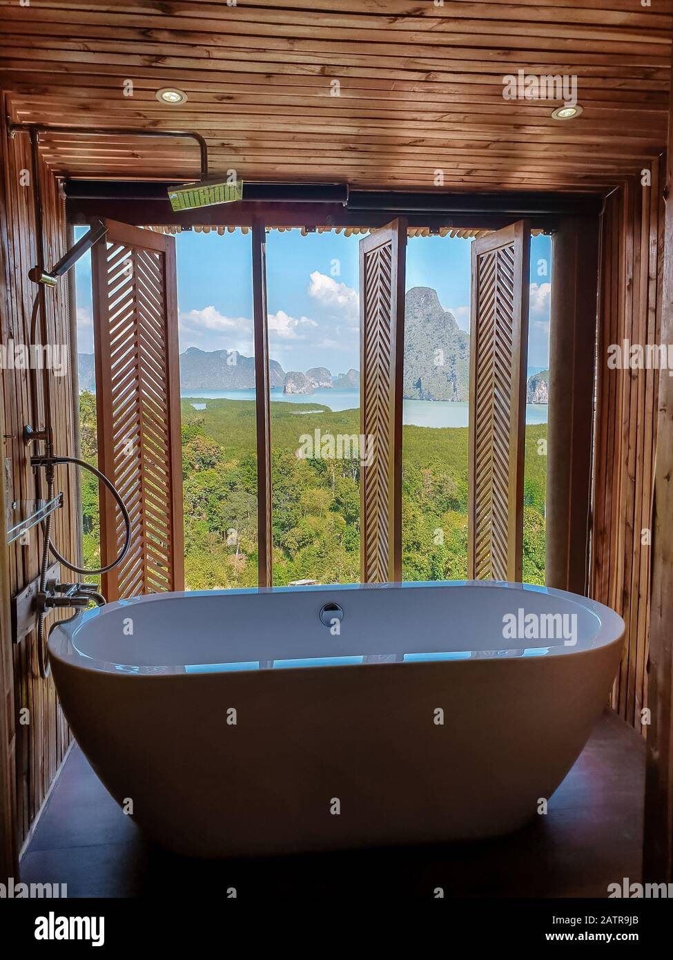 Luxury Bathroom Looking Out Over The Ocean Of Thailand Bath Tub In Wooden Room Stock Photo Alamy