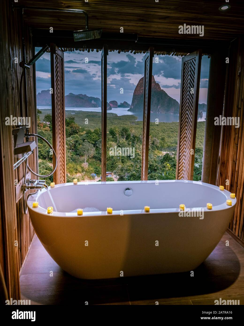 Luxury Bathroom Looking Out Over The Ocean Of Phangnga Bay Thailand Bath Tub In Wooden Room Stock Photo Alamy