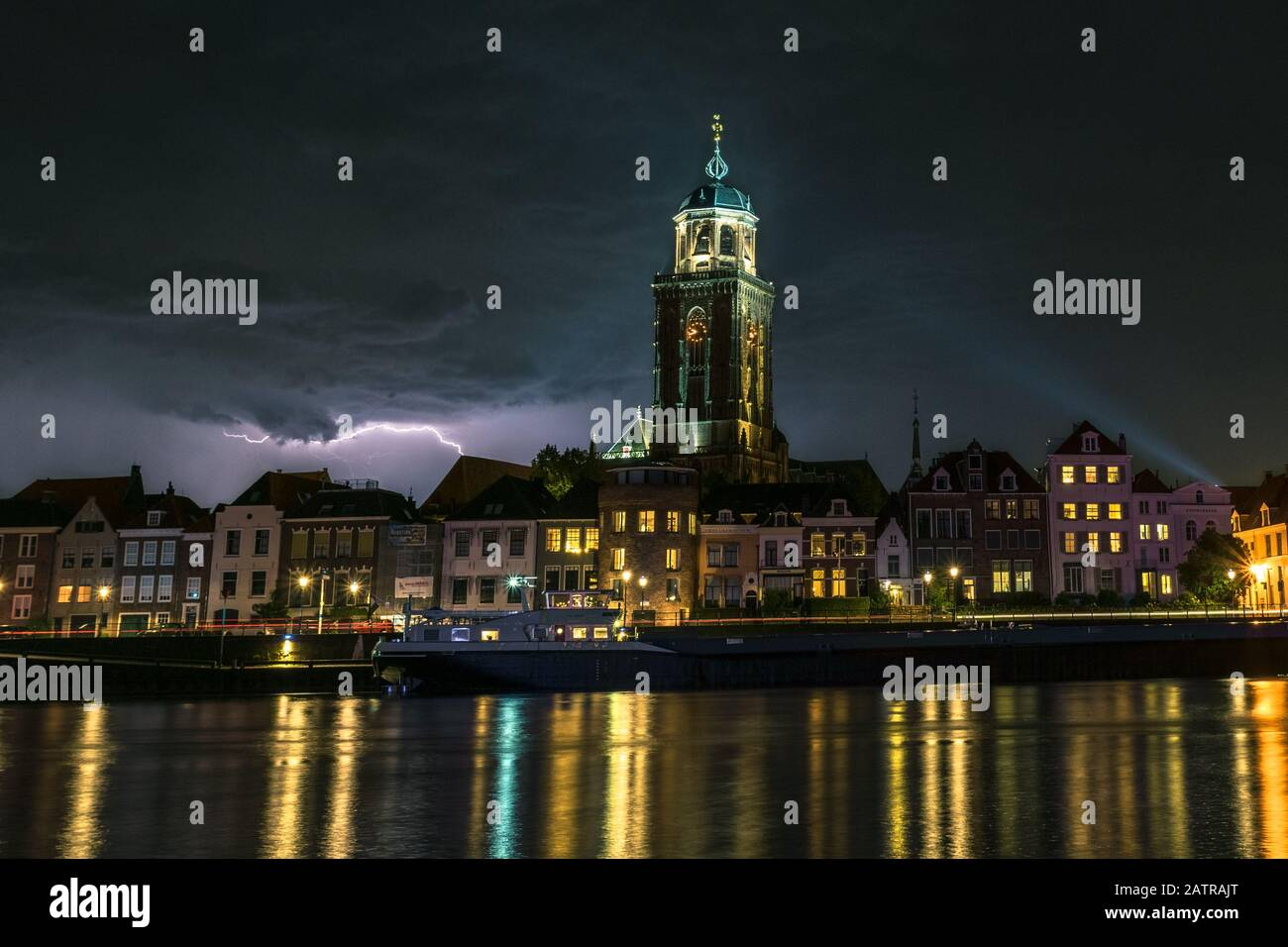 Stunning night image of lightning over a river and historic city of Deventer, the Netherlands. Stock Photo