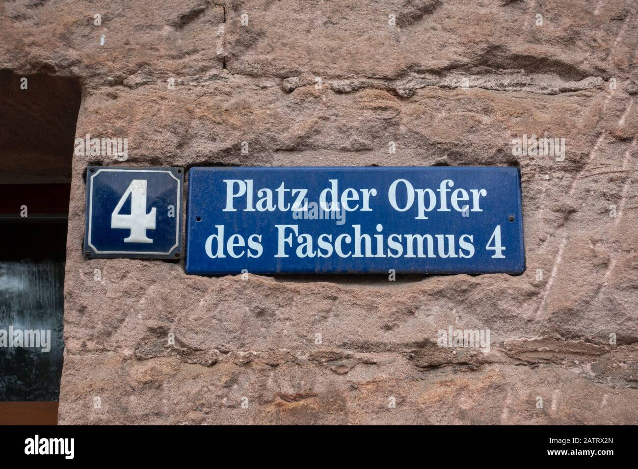 Street sign for Platz der Opfer des Faschismus (Place of Victims of Fascism) in Nuremberg, Bavaria, Germany. Stock Photo
