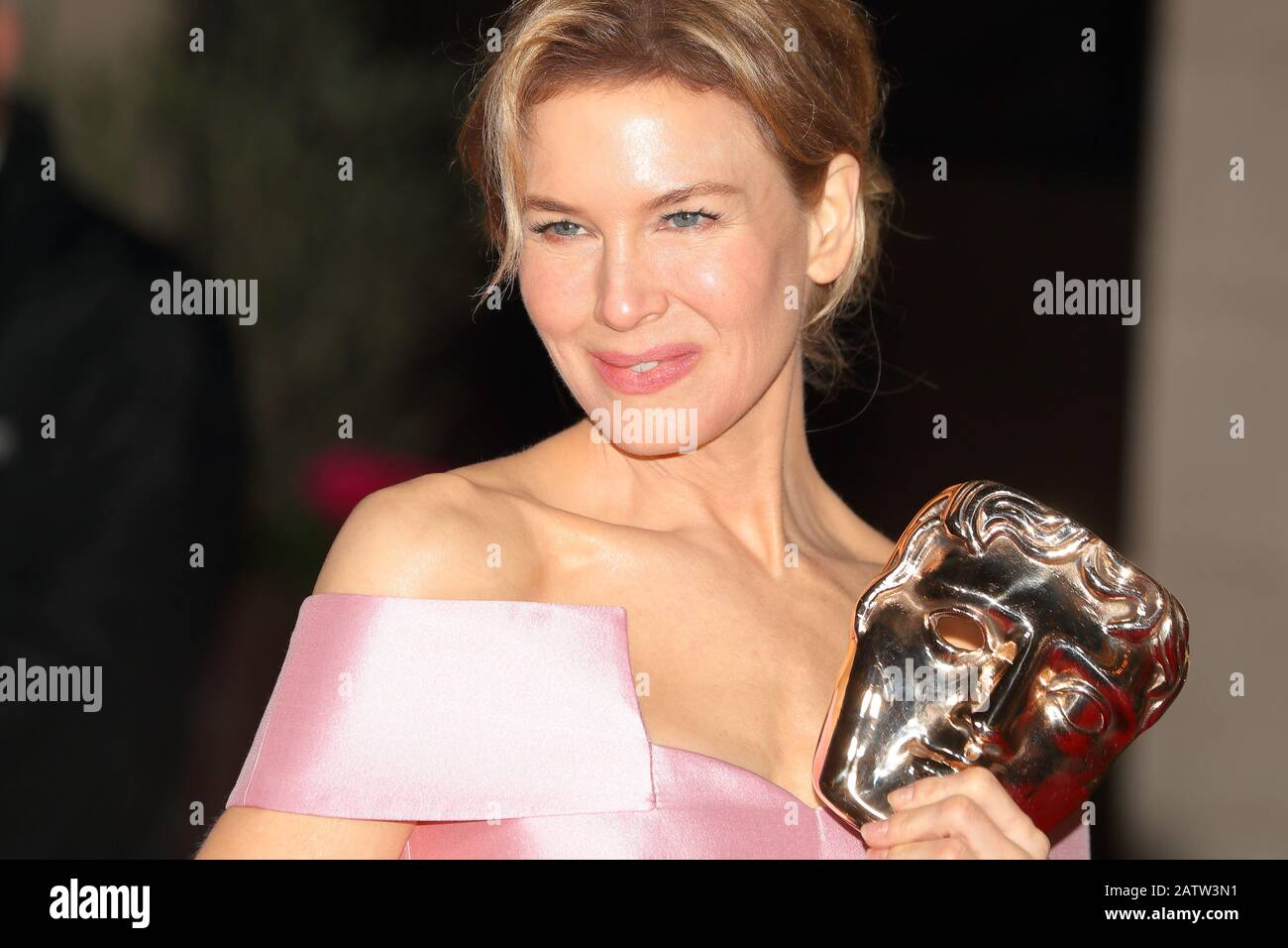 American actress Renee Zellweger showing her award at the EE BAFTA after-party dinner at the Grosvenor House Hotel in London, UK Stock Photo
