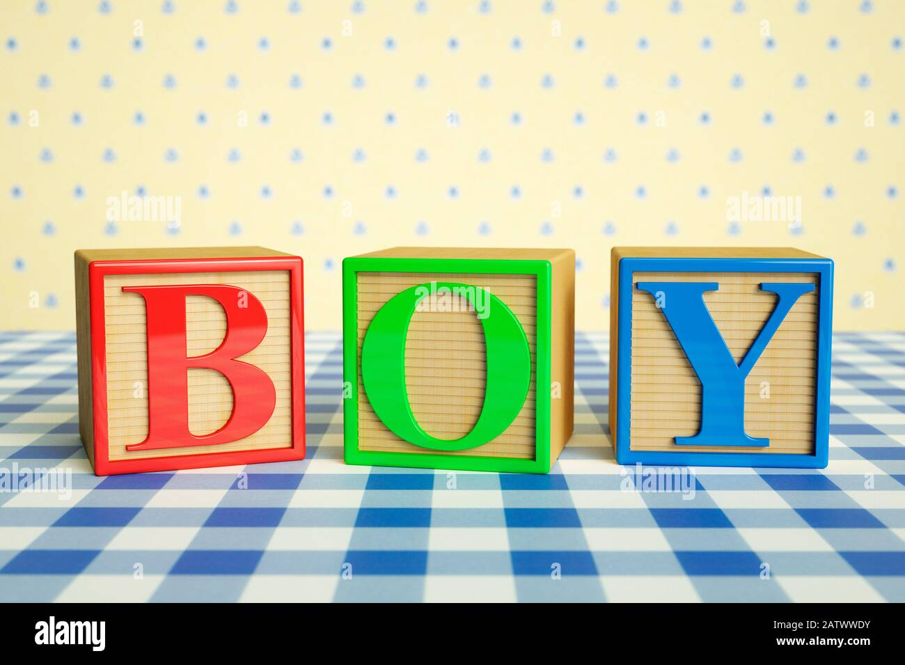 Childrens wooden ABC blocks spelling BOY on a checked tablecloth Stock Photo