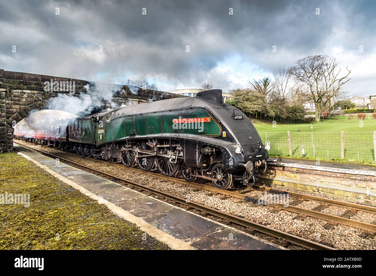 The famous LMS Class A4 4-6-2 60009 Union of South Africa steam train travelling at speed through High Bentham in North Yorkshire Stock Photo